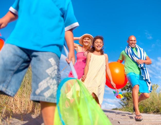 Cheerful family going to the beach Premium Photo