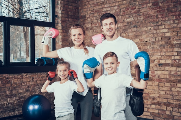 Cheerful family in the gym in boxing equipment. Premium Photo