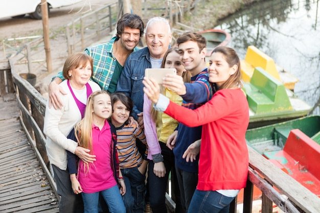 Cheerful family taking selfie outdoors Free Photo