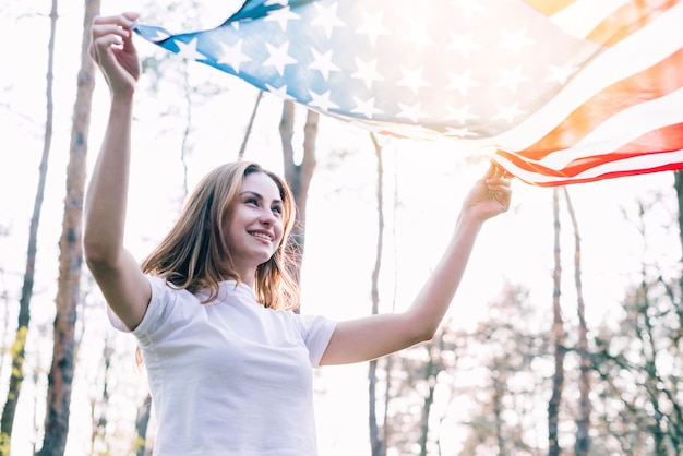 Cheerful female with national american flag Free Photo