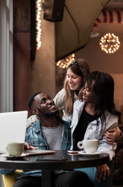 Cheerful friends laughing indoors Free Photo
