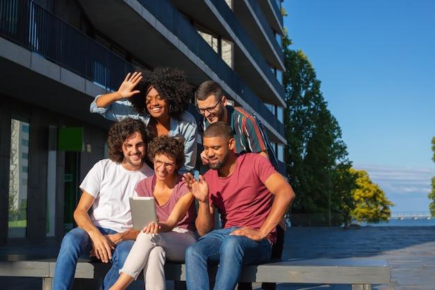 Cheerful friends using video talk app Free Photo
