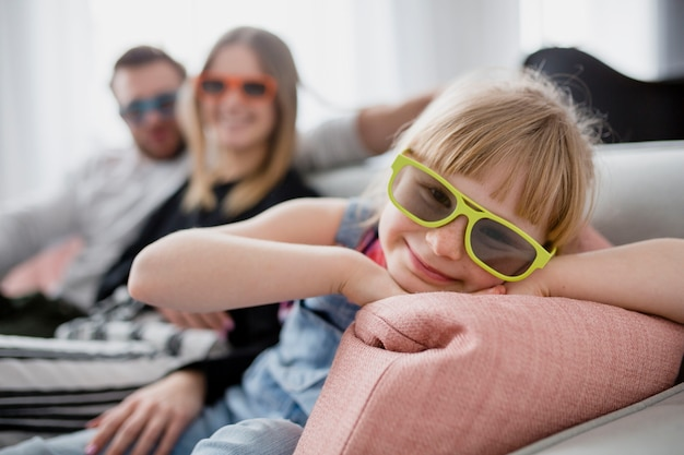 Cheerful girl in 3d glasses near parents Free Photo