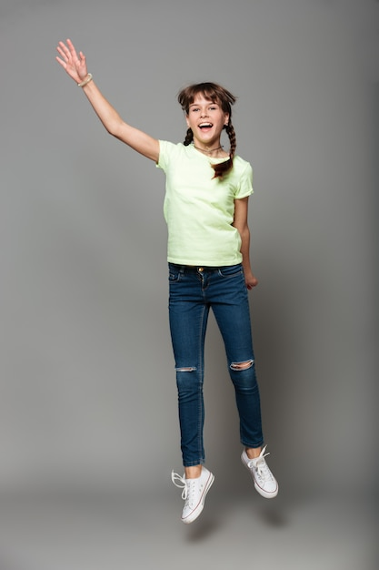 Cheerful girl jumping Free Photo