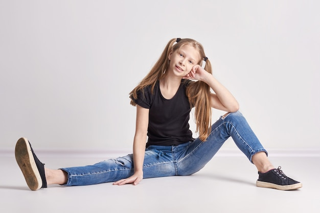 Cheerful girl with long pigtails posing Premium Photo