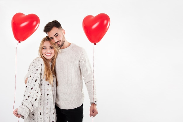 Cheerful man and woman posing with balloons Free Photo