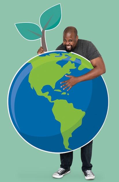 Веселый человек с символами сохранения окружающей среды Бесплатные Фотографии