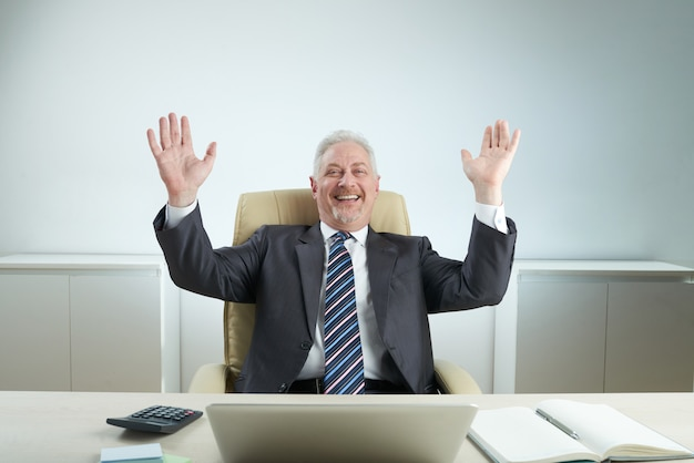 Cheerful manager celebrating success Free Photo