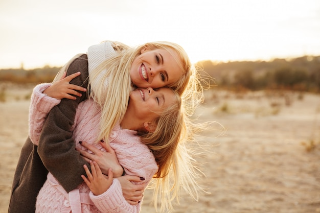 Cheerful mother playing with her little daughter Free Photo