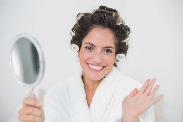 hand holding mirror. Cheerful Natural Brunette Holding Mirror And Waving Premium Photo Hand