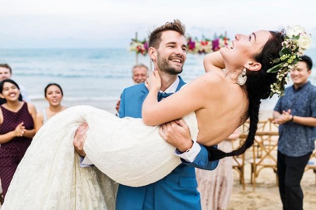 Cheerful newlyweds at beach wedding ceremony Premium Photo