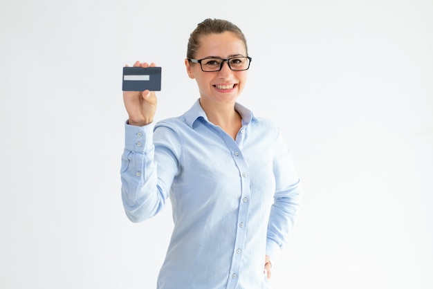 Cheerful office girl advertising credit card Free Photo