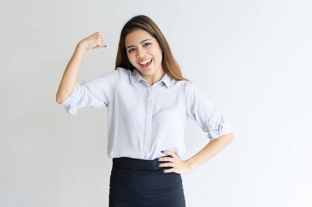Cheerful pretty woman pumping fist and celebrating achievement Free Photo