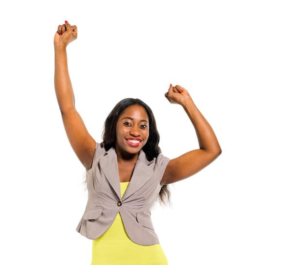Cheerful smart casual woman celebrating Free Photo