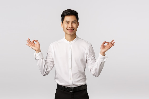 Cheerful smiling asian young entrepreneur with white shirt relieved Premium Photo