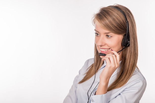Cheerful smiling support phone female operator in headset at off Free Photo