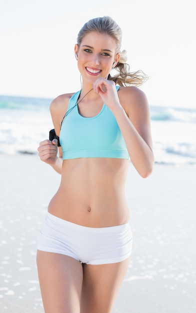 Cheerful sporty blonde in sportswear jogging Premium Photo