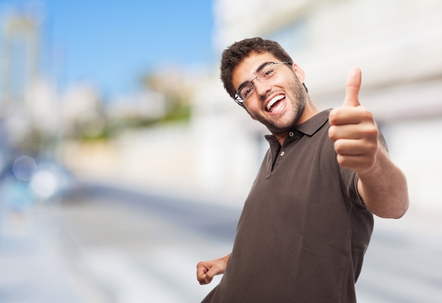 Cheerful student giving thumb up Free Photo