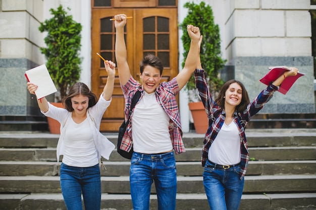Cheerful students celebrating Free Photo