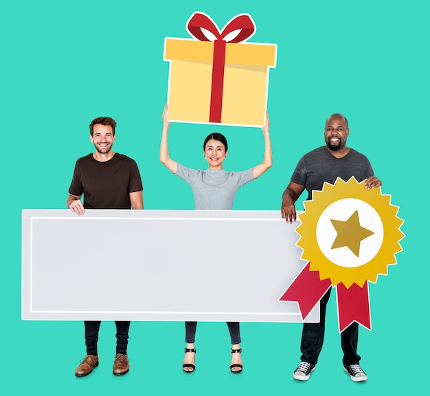 Cheerful team holding a competition award in blank banner Free Photo