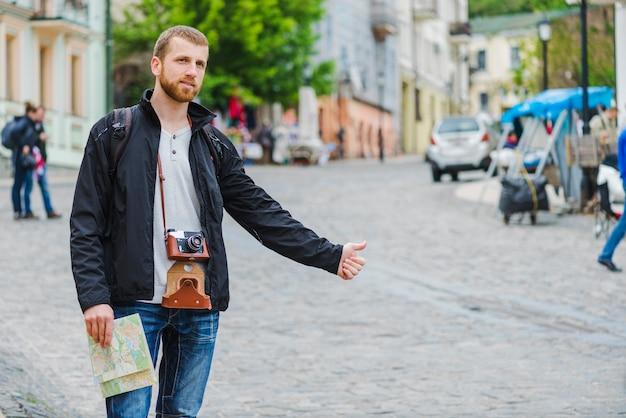 Cheerful tourist man hitchhiking 23 2147654217