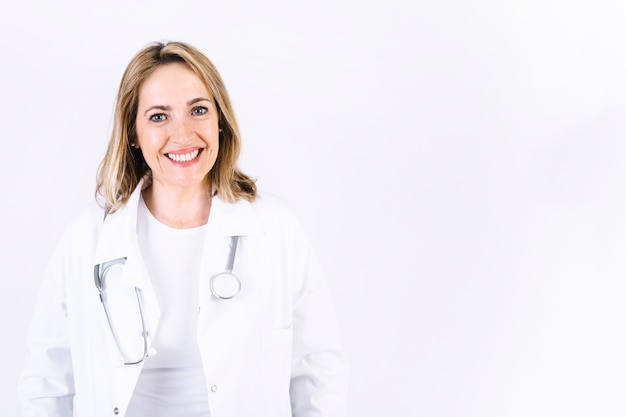 Cheerful woman in medical overall Free Photo
