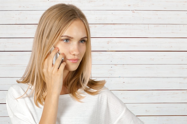 Cheerful woman talking on the phone isolated Premium Photo