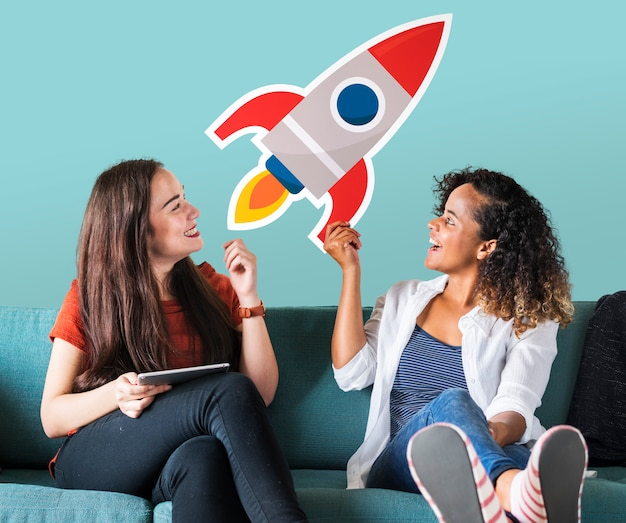 Cheerful women holding a rocket icon Free Photo