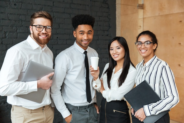 Cheerful young business colleagues Free Photo