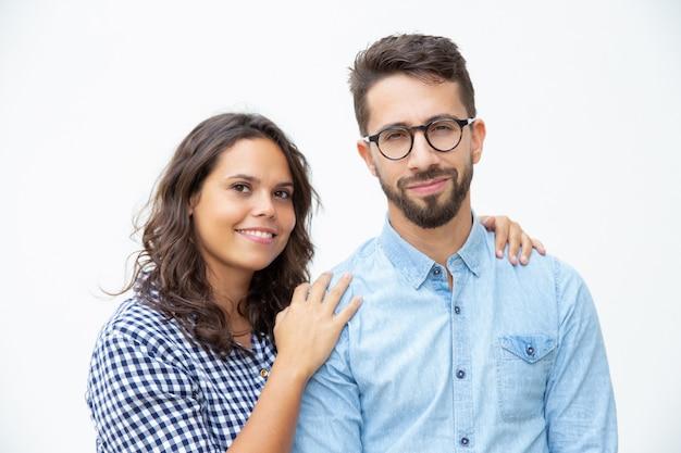 Cheerful young couple smiling at camera Free Photo