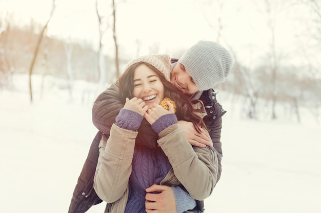 Cheerful young couple walking in a winter day Free Photo