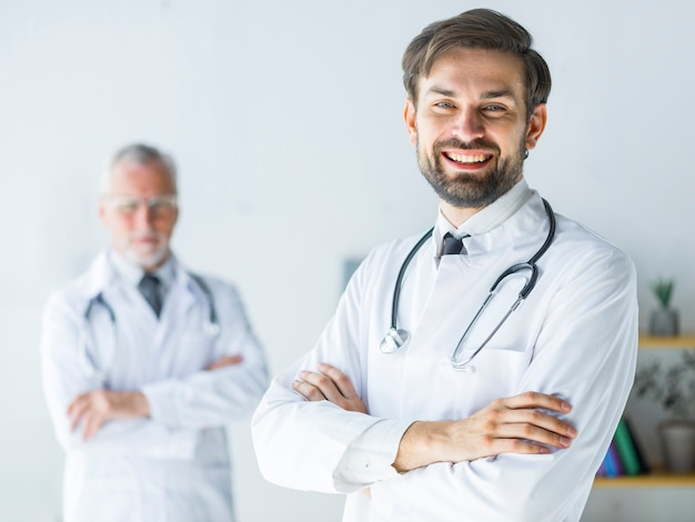 Cheerful young doctor in office Free Photo