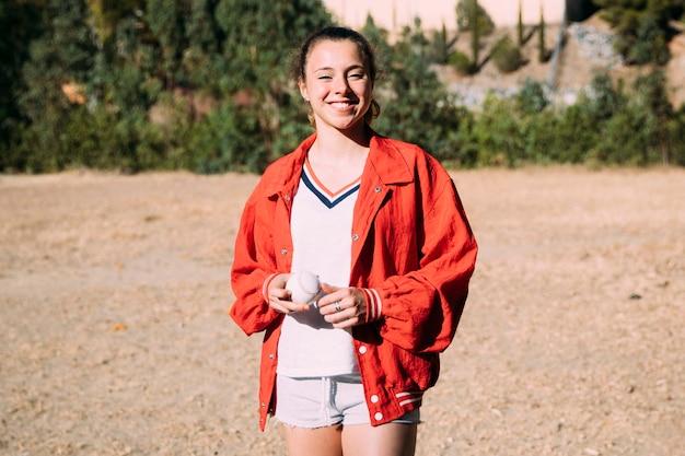 Cheerful young woman at baseball field Free Photo