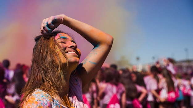 Cheerful young woman in holi festival Free Photo