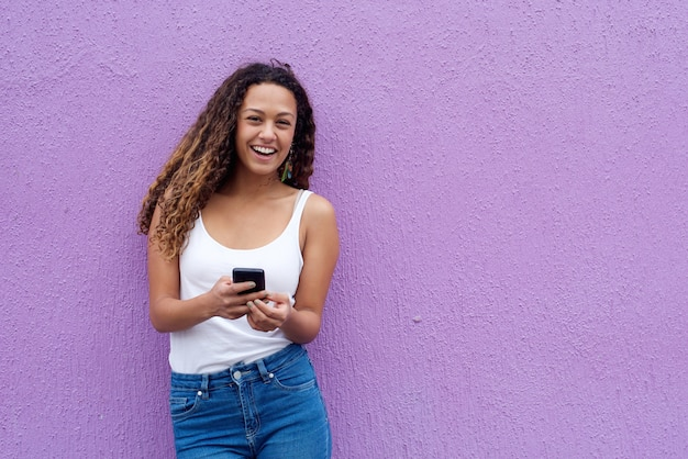 Cheerful young woman with mobile phone Premium Photo
