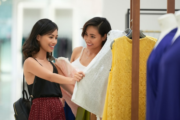 Cheerful young women shopping for clothes Free Photo