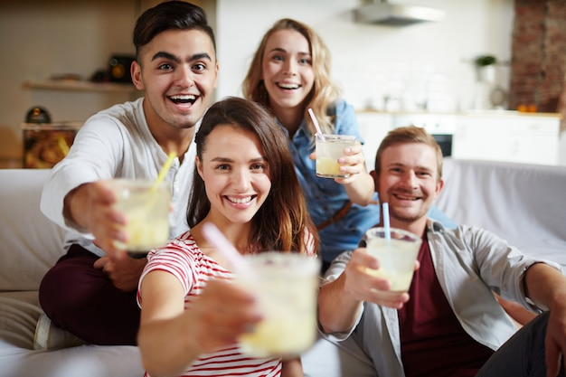 Cheers with drinks, group of friends Free Photo