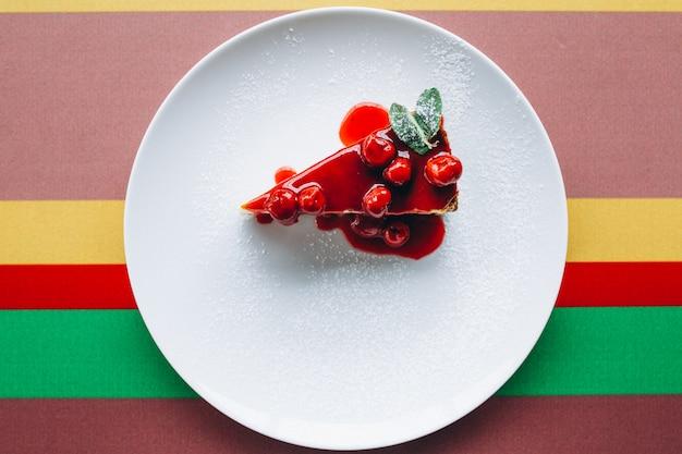 Cheescake slice on plate Free Photo