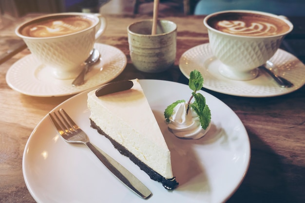 Cheese cake with cup of hot coffee in coffee shop Free Photo