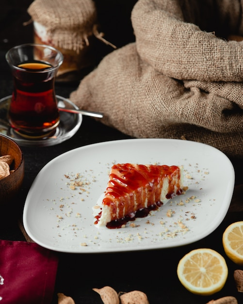 Cheese cake with strawberry syrup Free Photo