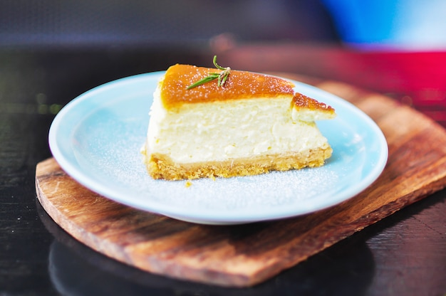 Cheese cake on wooden table Free Photo