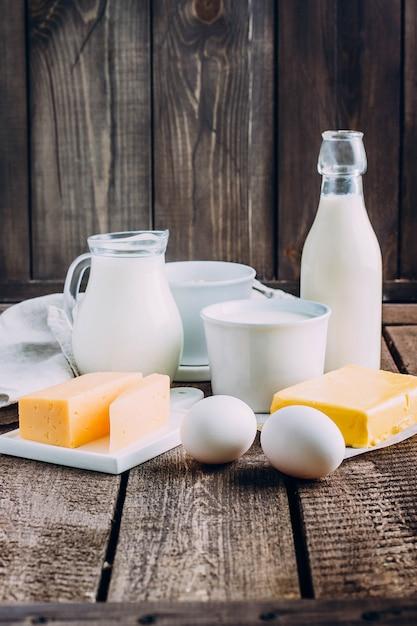 Cheese, eggs, milk, cottage cheese, yogurt, cream and butter Premium Photo
