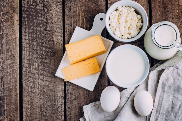 Cheese, eggs, milk, cottage cheese, yogurt, cream and butter Premium Photo