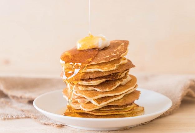 Cheese on pancake  with honey Free Photo