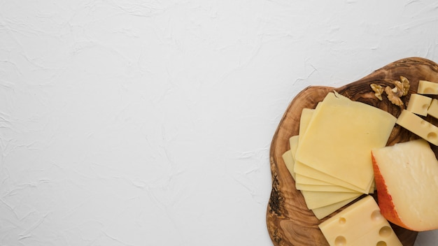 Cheese plate served with walnut isolated on white Free Photo