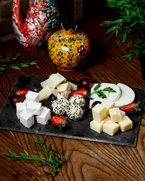 Cheese plate on the table Free Photo