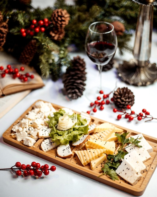 Cheese  plate with glass of red wine Free Photo