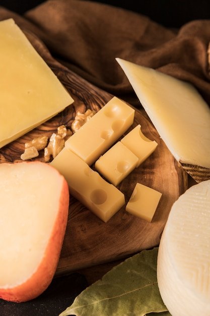 Cheese platter with different cheeses and walnut Free Photo
