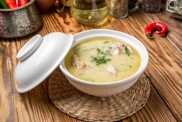 Cheese soup with chicken and vegetables Premium Photo