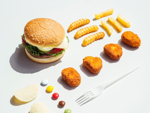 Cheeseburger with french fries and nuggets Free Photo